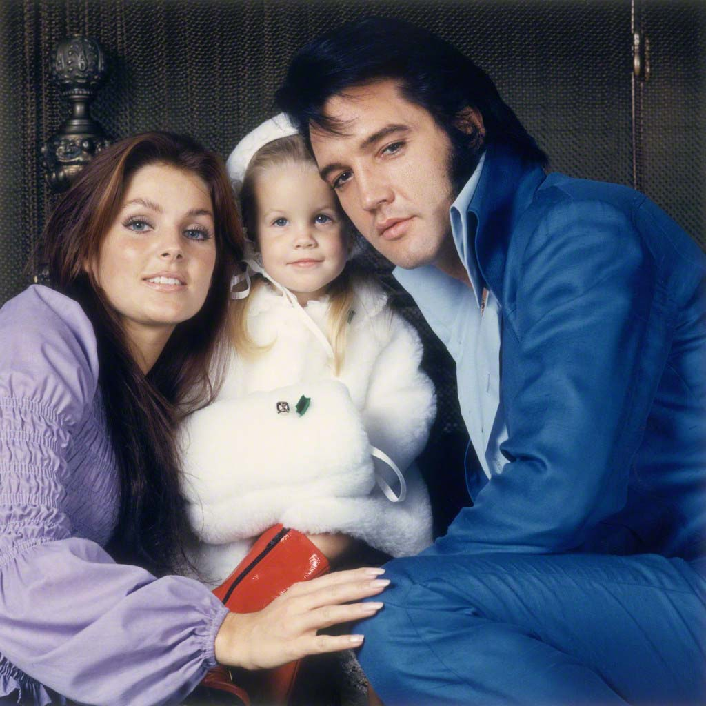December 1969, Beverly Hills, California, USA --- American rock legend Elvis Presley with his wife Priscilla and their daughter Lisa-Marie. --- Image by © Frank Carroll/Sygma/Corbis