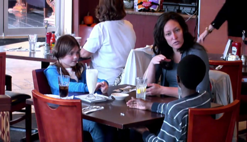 8-Mom-And-Daughter-Tucked-Into-A-Meal