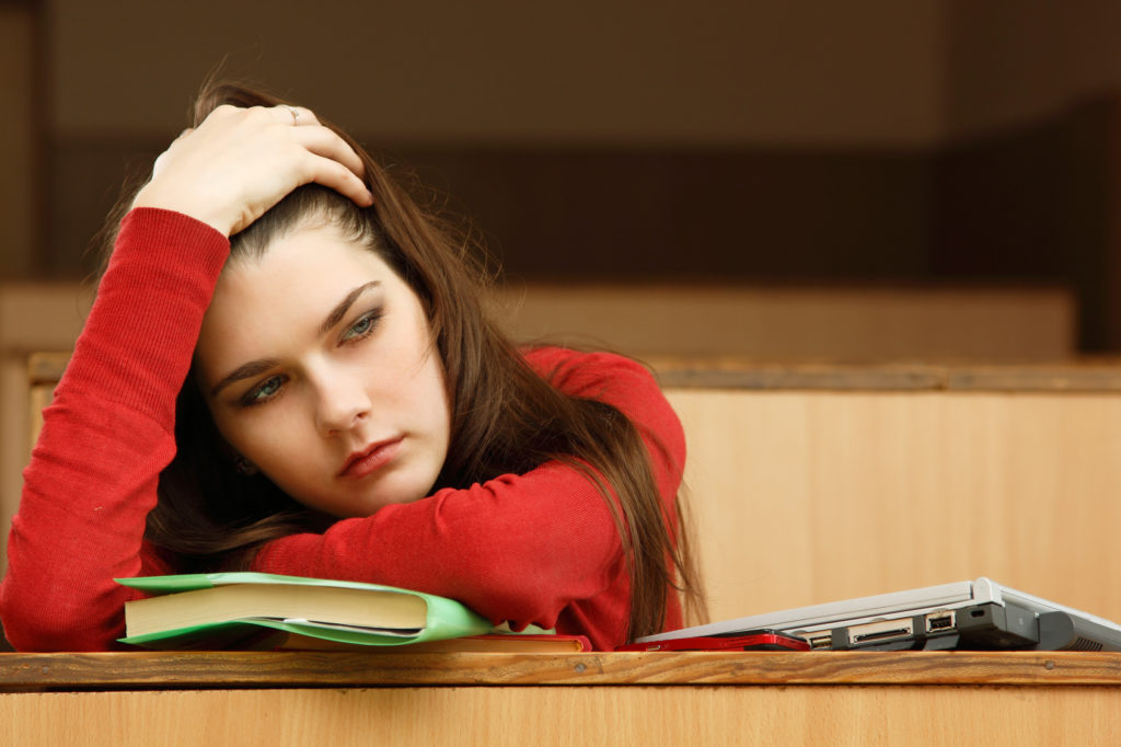 student teen girl beautifyl tired in empty classroom university